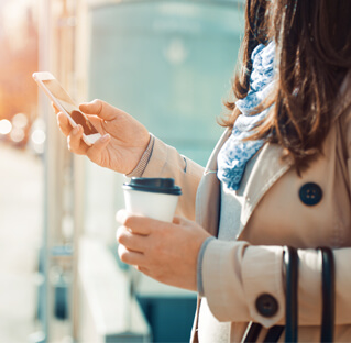 woman buying coffee using novahub